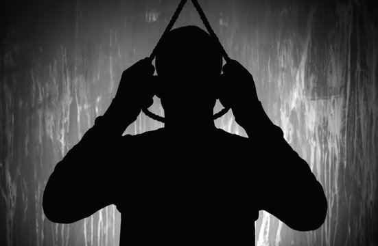 Silhouette of male suicider going to hang himself against grunge background