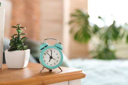 Alarm clock on table in bedroom