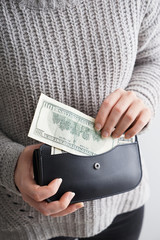 Woman holding wallet with money, closeup