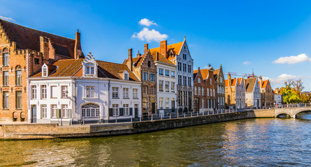 Bruges canal Spiegelrei with beautiful houses at sunset. Panoramic city view of traditional buildings and water canal. Wall mural
