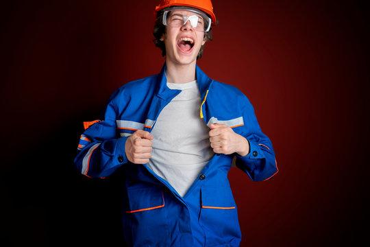 male worker open or tear uniform (jacket) under t-shirt b