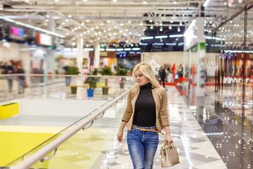 Beautiful shopping woman at a mall smiling
