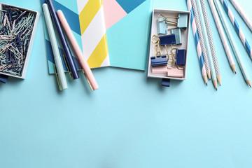 Stylish stationery on color background