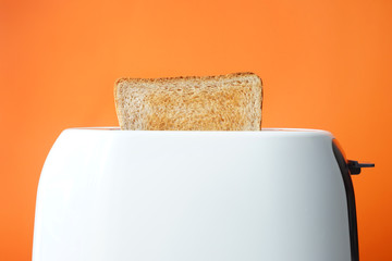 Slice of bread with toaster on color background Wall mural