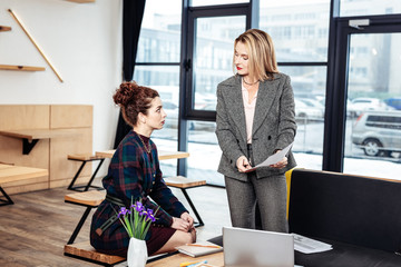 Businesswoman explaining financial issues to her young partner