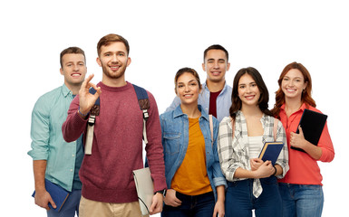 education, high school and people concept - group of smiling students with books showing ok hand sign over white background