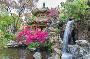 pavilion and waterfall in oriental garden in Hong Kong, China
