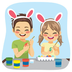 Young cute siblings painting decorated Easter eggs funny creative activity