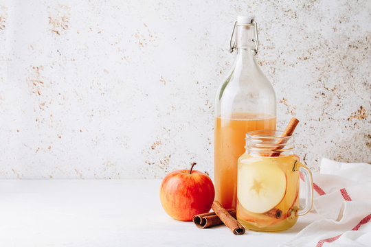 Cool, healthy drink with apple cider vinegar, honey, apples and cinnamon
