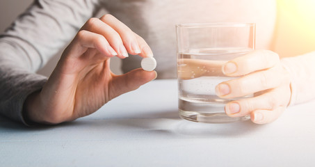 Woman drink pills in morning