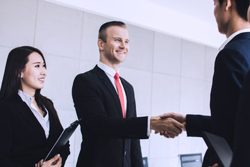 successful negotiation and deal concept, shake hands and  of business people