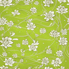 Seamless pattern with contour flowers and leaves on a green background