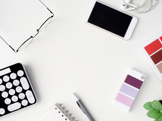 top view of office desk work space with notebook, graphic tablet, smartphone and gadget on white background with copy space, graphic designer, Creative Designer concept.