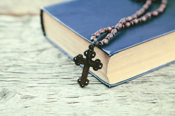 cross with a book on the table