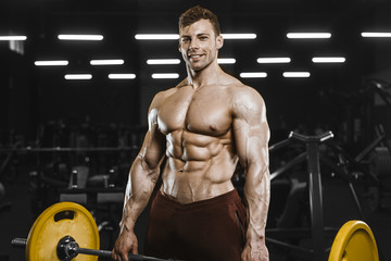 Foto op Plexiglas Fitness Handsome strong athletic men pumping up muscles workout bodybuilding