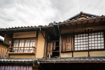 Old traditional Japanese house detail with the specific roof tiles on a street in Gion District, Kyoto, Japan.