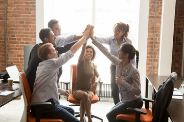 Motivated happy diverse office people group giving high five
