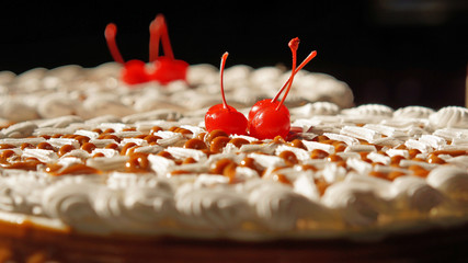 Fancy cake with cherries on top