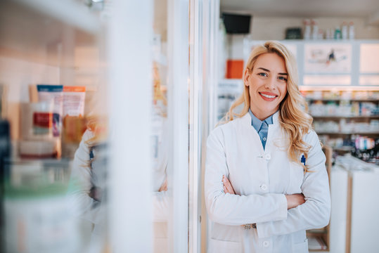 Portrait of a young smiling blonde pharmacist.