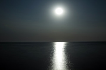 Moon above the water with moonlight
