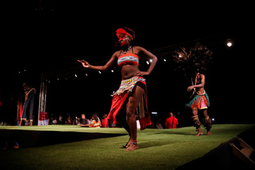 A model walks on a catwalk during a fashion show featuring African fashion and culture during a gala at the African Heritage House in Nairobi
