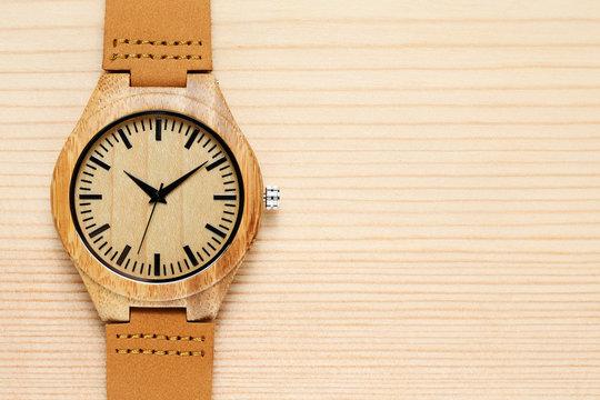 Wooden watch on wooden background