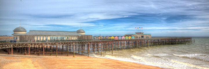 Hastings beach and pier East Sussex England UK in colourful HDR panoramic view