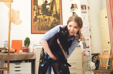 beautiful girl hugging a big black cat Wall mural