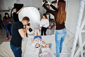 Work process of team photographer, designers and models stuff on photosession, master class of proffesionals.