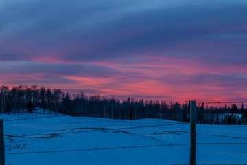 Sunset over a farmers field, Cowboy Trail, Alberta, Canada