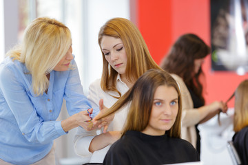 teacher helping student hairdressers