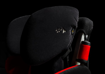 Safety car child seat isolated view, black and red
