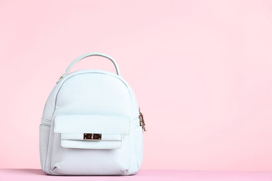 Fashion woman backpack on pink background