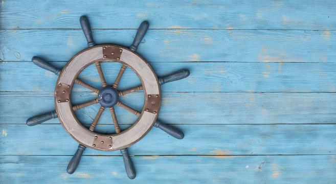 old sea wooden steering wheel