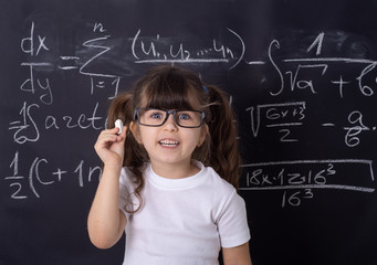Studio shoot, Cute kid back to school. Little girl with glasses.