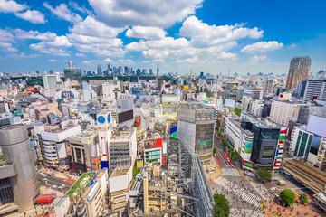 Shibuya, Tokyo, Japan city skyline over Shibuya Scramble Crosswalk