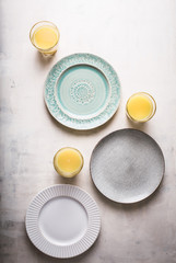 Plates and Orange Juice