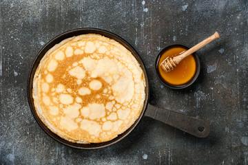 Homemade pancakes on iron pan