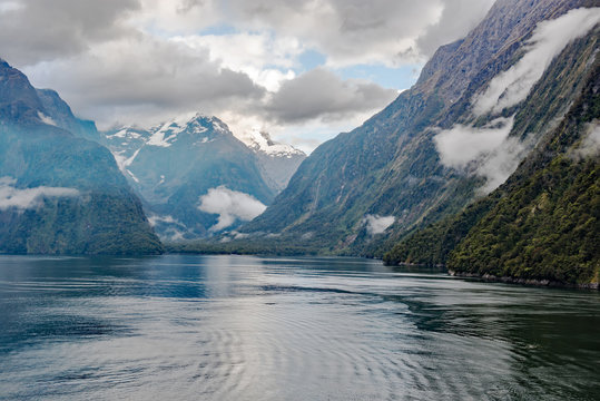 Morning passage through the iconic Milford Sound in Fiordland National Park, South Island, New Zealand