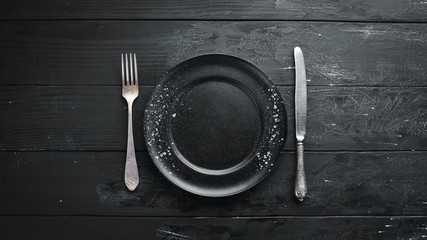 Old cutlery on a dark background. Top view. Free copy space.