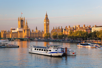 Fototapete - Big Ben and Houses of Parliament with boat in London, England, UK