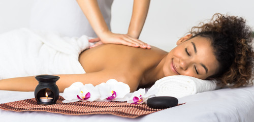 Woman enjoying aroma massage in spa salon