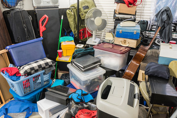 Hoarder home packed with stored boxes, vintage electronics, files, business equipment and household items.