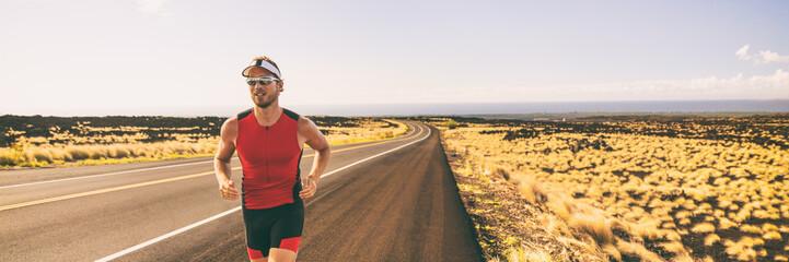 Running man training for triathlon sport run race in Hawaii. Banner panorama landscape sunset nature, triathlete runner jogging.