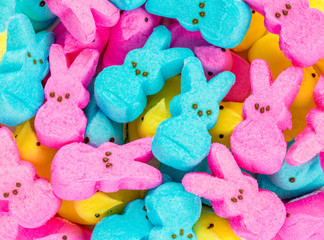 background texture-colorful marshmallow Easter peeps in a large pile