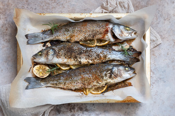 Fish seabass roasted with lemon and herbs