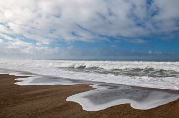 Pacific ocean wave tidal overflowing into Santa Clara river estuary at Ventura California United States