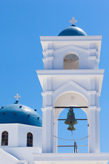 The bell tower and dome of the Anastasi church in Imerovigli, Santorini, Greece