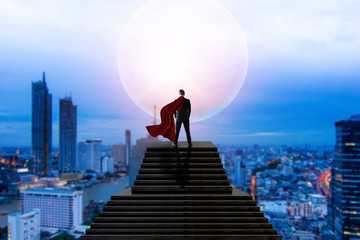 super hero business man in suit standing and looking on cityscape view and thinking business plan of the future