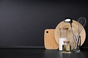 Composition with kitchenware on table against grey background. Space for text